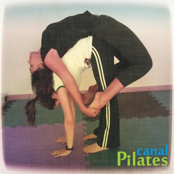 alongamento coluna pilates solo